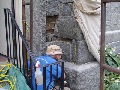 replace shoulder buttress stones on chapel